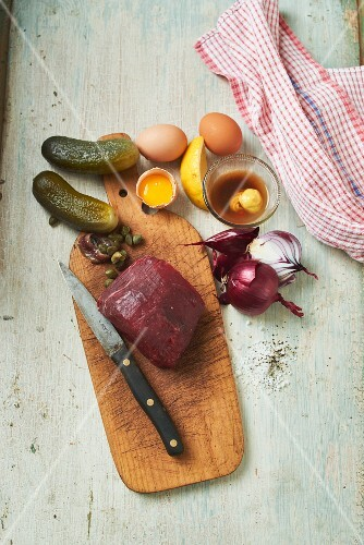 Ingredients for beef tatar: beef, gherkins, capers, onions and eggs
