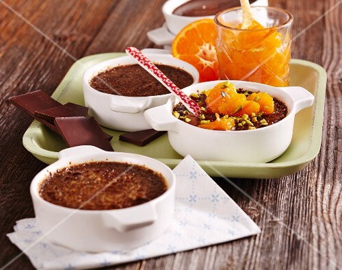 Chocolate crème brûlée with mandarins and pistachio nuts