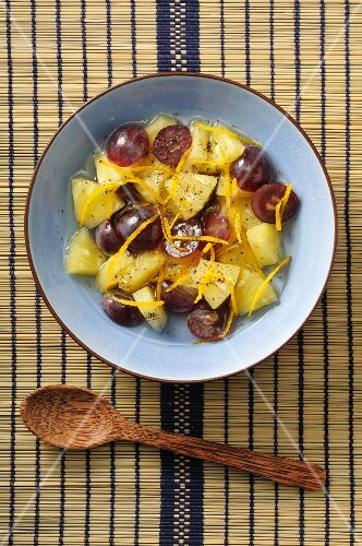 Pineapple salad with grapes and oranges