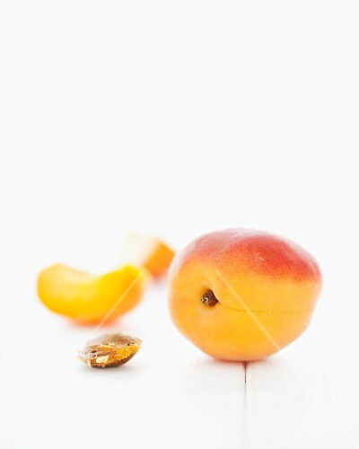 Apricots, an apricot wedge and an apricot stone