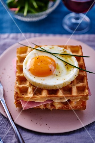 Waffles with fried eggs and ham