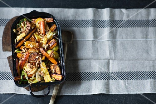 Coloured, oven-roasted carrots in a baking dish