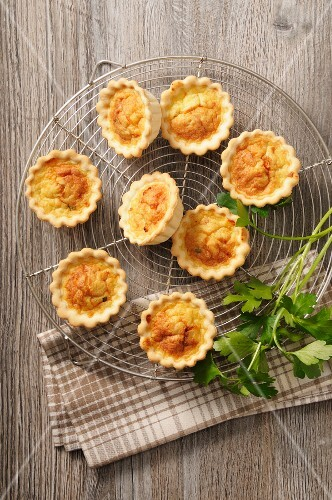 Spicy mini quiche on a cooling rack