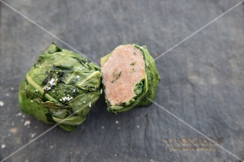 A sausage meatball wrapped in cabbage
