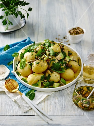 Potato salad with new potatoes, avocado, herbs and seeds