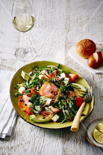 Rocket salad with smoked salmon, avocado and feta cheese