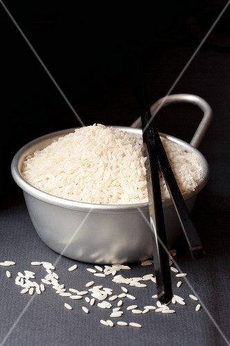 A bowl of rice with chopsticks