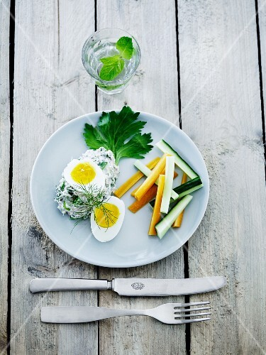 Tuna fish mousse with herbs served with soft boiled eggs and julienned vegetables
