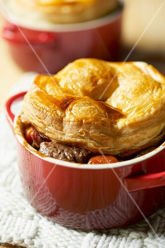 A beef pie with a puff pastry lid