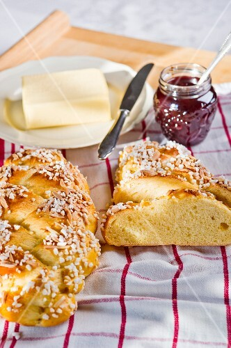 Brioche with sugar nibs, butter and jam