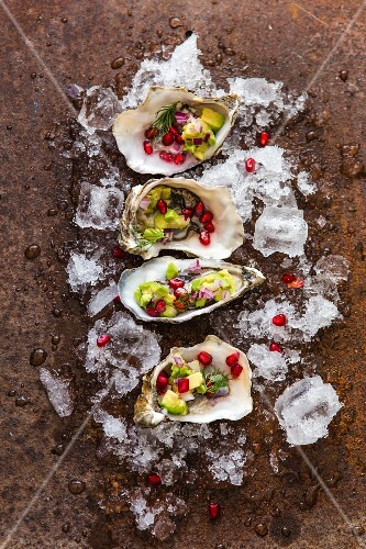 Fresh oysters with avocado and pomegranate seeds