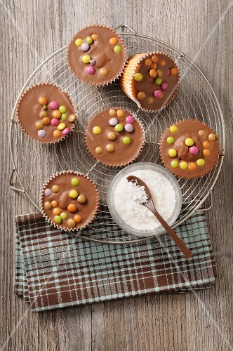 Cupcakes with chocolate glaze and chocolate beans