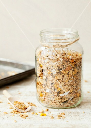 Homemade granola muesli with mango and coconut in a screw-top jar