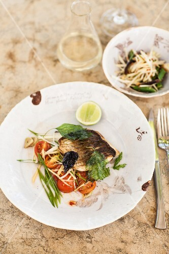Grilled fish with tomato salad
