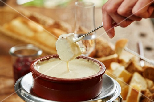 Cheese fondue and pieces of white bread