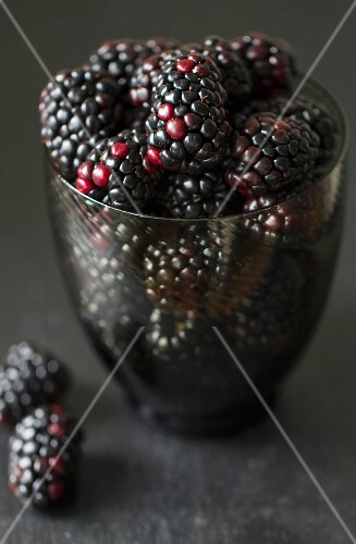 A glass of blackberries