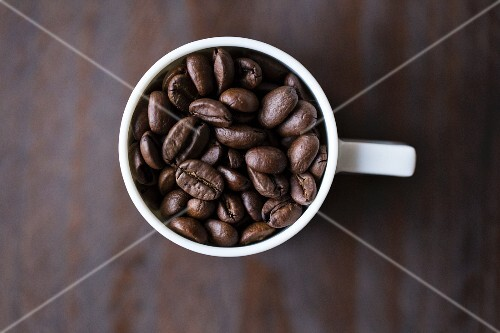 Coffee beans in an espresso cup (seen from above)