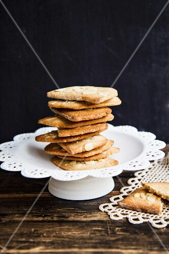 A stack of puff pastry biscuits with almonds