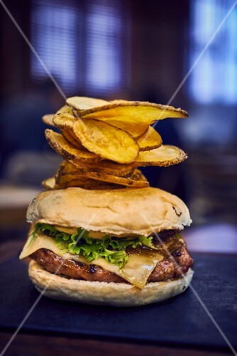 Cheeseburger with potato crisps in a restaurant
