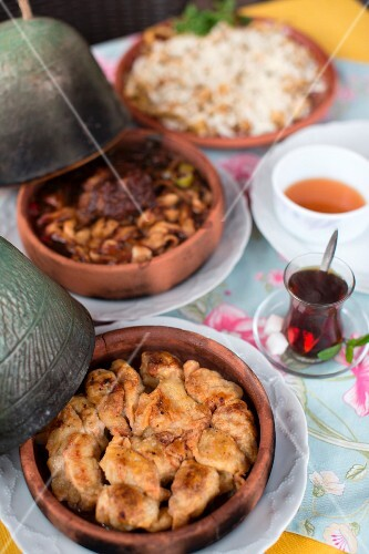 A selection of Turkish dishes and tea on a table