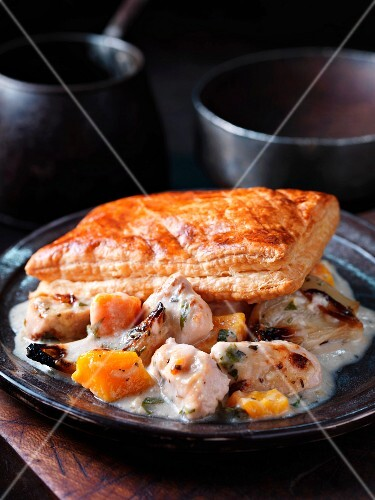 Chicken ragout with pumpkin and puff pastries