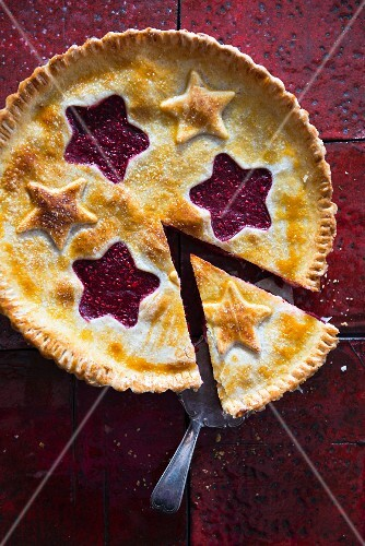 Raspberry pie with pastry stars, sliced