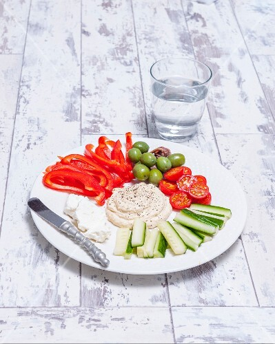A selection of raw Mediterranean vegetables with a dip
