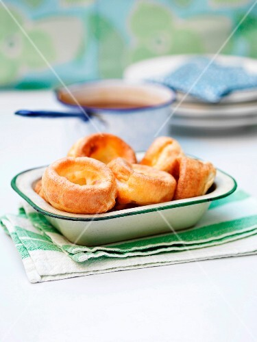 Yorkshire puddings in a ceramic dish on a table