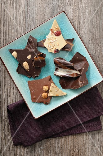 Various pieces of chocolate on a plate