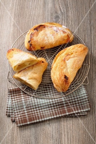 Apple turnovers on a wire rack