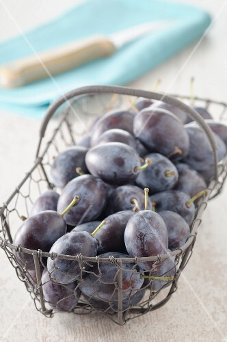 Damsons in a wire basket