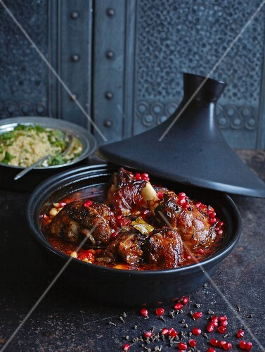 Lamb tagine with pomegranate, cinnamon flowers and orange couscous (North Africa)