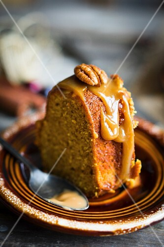 A slice of autumnal nut cake with caramel glaze