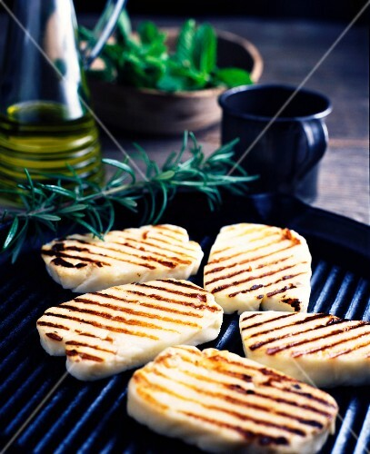 Halloumi cheese with rosemary on a barbecue