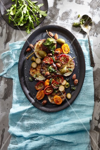 Tagliata Melanzane with aubergines, olives, cherry tomatoes, caper fruits and herbs