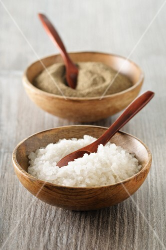Salt and pepper in wooden bowls