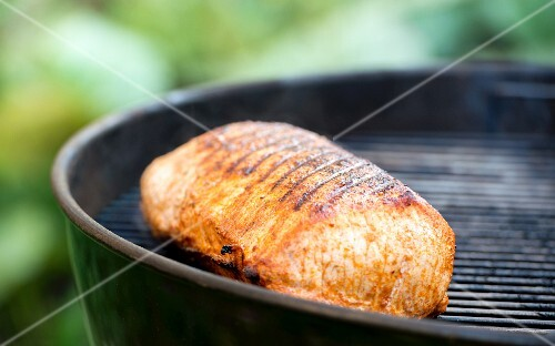 Grilled pork loin on a barbecue