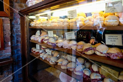 Sandwiches at the bar 'Al Merca' at the Rialto market, Venice, Italy