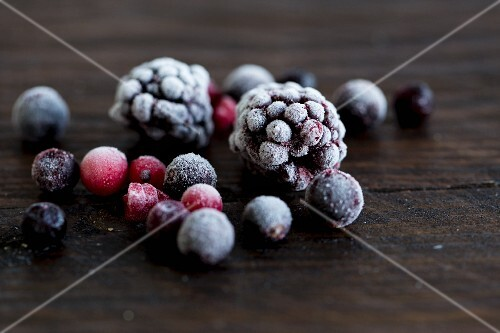 Frozen forest berries on a wooden surface