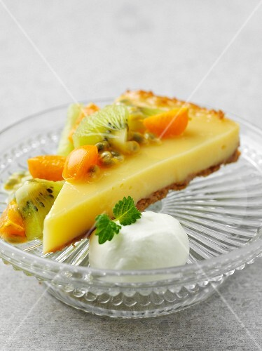 A slice of lemon curd cake with exotic fruit