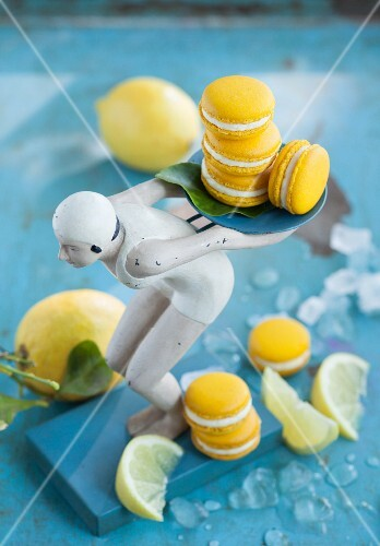 Lemon macaroons with a vintage figure