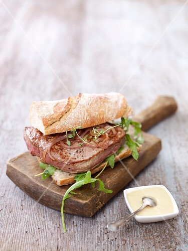 A sandwich with beef fillet and caramelised onions