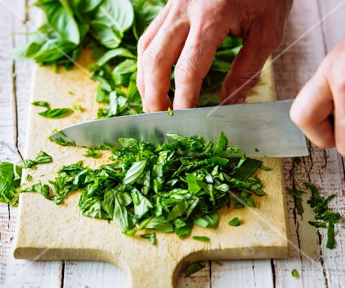 Basil being chopped