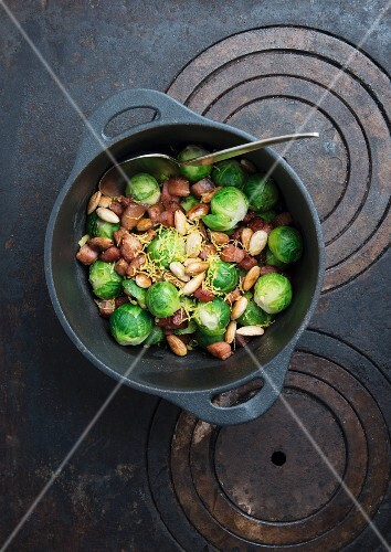 Steamed brussels sprouts with bacon, roasted almonds and grated lemon zest