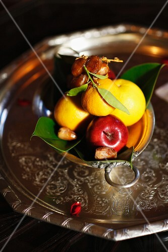 A fruit platter with lemons, apples and date, Marrakesh, Morocco
