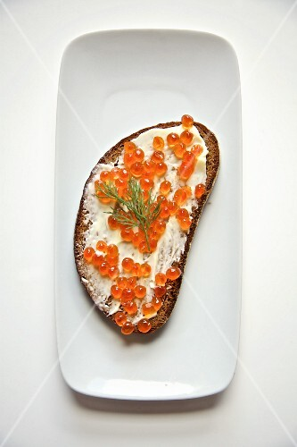 Slice of bread-and-butter topped with salmon caviar (Russia)