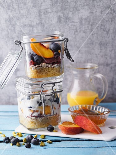 Peach and blueberry muesli with bulgur in jars