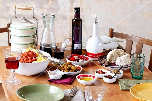 A table laid with Italian dishes and products