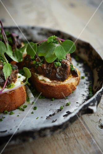 Bruschetta topped with aubergine tapenade and cress