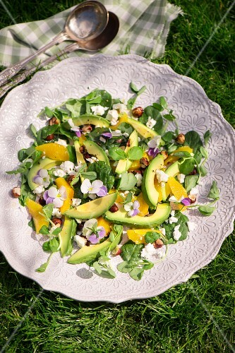 Spring salad with avocado and pansies